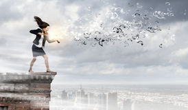 Businesswoman with violin Royalty Free Stock Photography