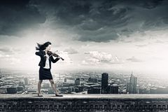 Businesswoman with violin Royalty Free Stock Images