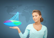 Businesswoman with virtual charts and graphs Stock Photo