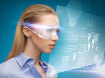 Businesswoman with virtual glasses Stock Photography