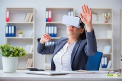 The businesswoman with virtual reality glasses in office Stock Images