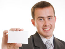 Businesswoman with visit card in his hand. Royalty Free Stock Images
