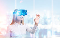 Businesswoman in vr glasses in office Stock Images