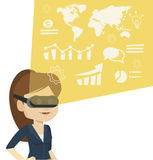 Businesswoman in vr headset analyzing virtual data Royalty Free Stock Photo
