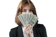 Businesswoman with wad of money in her hands. Portrait of young businesswoman with wad of money in her hands isolated on white Royalty Free Stock Photo