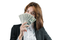 Businesswoman with wad of money in her hands. Portrait of young businesswoman with wad of money in her hands isolated on white Royalty Free Stock Images