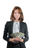 Businesswoman with wad of money in her hands. Portrait of young businesswoman with wad of money in her hands isolated on white Royalty Free Stock Photography