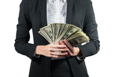 Businesswoman with wad of money in her hands. Portrait of young businesswoman with wad of money in her hands isolated on white Royalty Free Stock Image