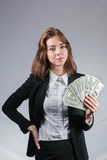 Businesswoman with wad of money in her hands. Portrait of young businesswoman with wad of money in her hands isolated on white Stock Photography