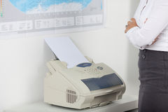 Businesswoman Wait For Fax Stock Photography