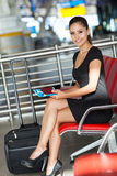 Businesswoman waiting airport. Attractive young businesswoman waiting at airport Stock Photography