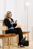 Businesswoman waiting for appointment Stock Photography