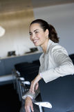 Businesswoman waiting in empty lecture hall Royalty Free Stock Image
