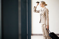 Businesswoman waiting flight Royalty Free Stock Photo