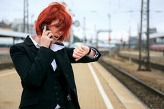 Businesswoman Waiting For The Train Stock Photos