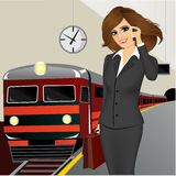Businesswoman waiting for the train Royalty Free Stock Photos