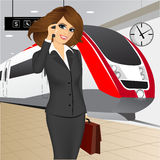 Businesswoman waiting for the train Stock Photo