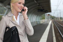 Businesswoman waiting for a train Royalty Free Stock Photography