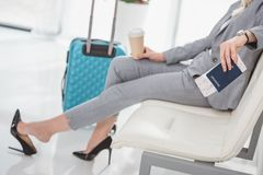 Businesswoman waiting for trip. Cropped shot of businesswoman with coffee to go waiting for trip Stock Photo
