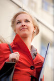 Businesswoman on the walk. A blond beautiful woman outdoors Stock Photo