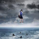 Businesswoman walk above ocean Stock Photos