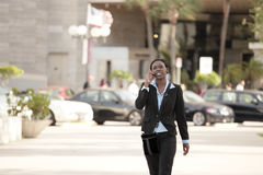 Businesswoman walking Stock Images