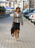 Businesswoman walking Royalty Free Stock Images