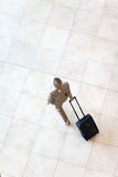 Businesswoman walking airport. Overhead view of young businesswoman walking at airport Royalty Free Stock Images