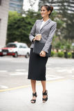 Businesswoman Walking Along Street Royalty Free Stock Image