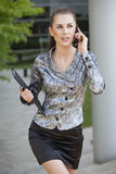 Businesswoman Walking And Talking On Cell Phone Stock Images