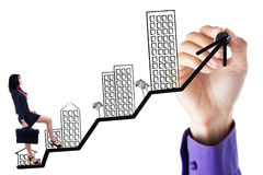 Businesswoman walking on the business property graph Stock Photo