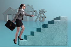 The businesswoman walking climbing stairs in mortgage. Businesswoman walking climbing stairs in mortgage Stock Images