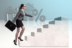 The businesswoman walking climbing stairs in mortgage. Businesswoman walking climbing stairs in mortgage Royalty Free Stock Image