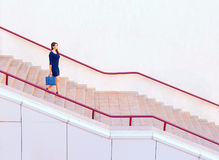 Businesswoman walking down stairs Royalty Free Stock Photography