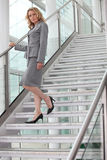 Businesswoman walking down steps Royalty Free Stock Photo