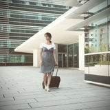 Businesswoman walking with her luggage Stock Image