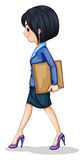 A businesswoman walking while holding the documents Royalty Free Stock Images