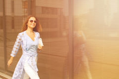 Businesswoman walking near office building Royalty Free Stock Photo
