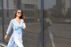 Businesswoman walking near office building Stock Photography