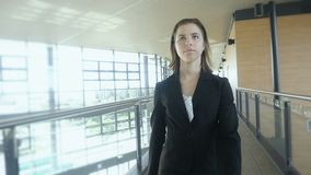 Businesswoman walking in office building Slow motion. Confident attractive executive businesswoman walking inside office building on her way to a meeting with a stock footage