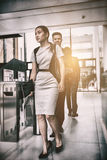 Businesswoman walking in office Stock Image