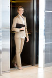 Businesswoman walking out elevator Royalty Free Stock Photography