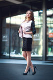 Businesswoman walking outdoors, Office worker in downtown business district. Royalty Free Stock Images