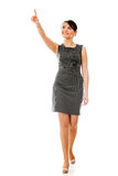 Businesswoman walking and pointing Stock Photo