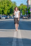 Businesswoman walking on the road Stock Photography
