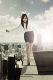Businesswoman walking on the rooftop Royalty Free Stock Photos