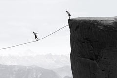 Businesswoman walking on the rope over the gap. Image of businesswoman taking risk and walking on the rope over the gap Stock Images