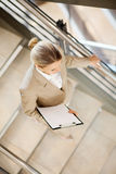 Businesswoman walking stairs Stock Image
