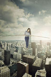 Businesswoman walking with a stick on the rope Royalty Free Stock Photo