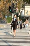 Businesswoman walking on street stock photo